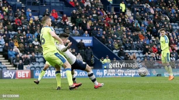 Preston North End's Sean Maguire goes down in the penalty area under the challenge from Derby County's Alex Pearce during the Sky Bet Championship...