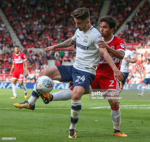 Preston North End's Sean Maguire holds off the challenge from Middlesbrough's Fabio during the Sky Bet Championship match between Middlesbrough and...