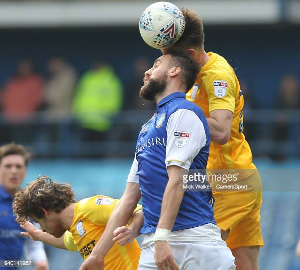 Preston North End's Sean Maguire jumps with Sheffield Wednesday's Atdhe Nuhiu during the Sky Bet Championship match between Sheffield Wednesday and...