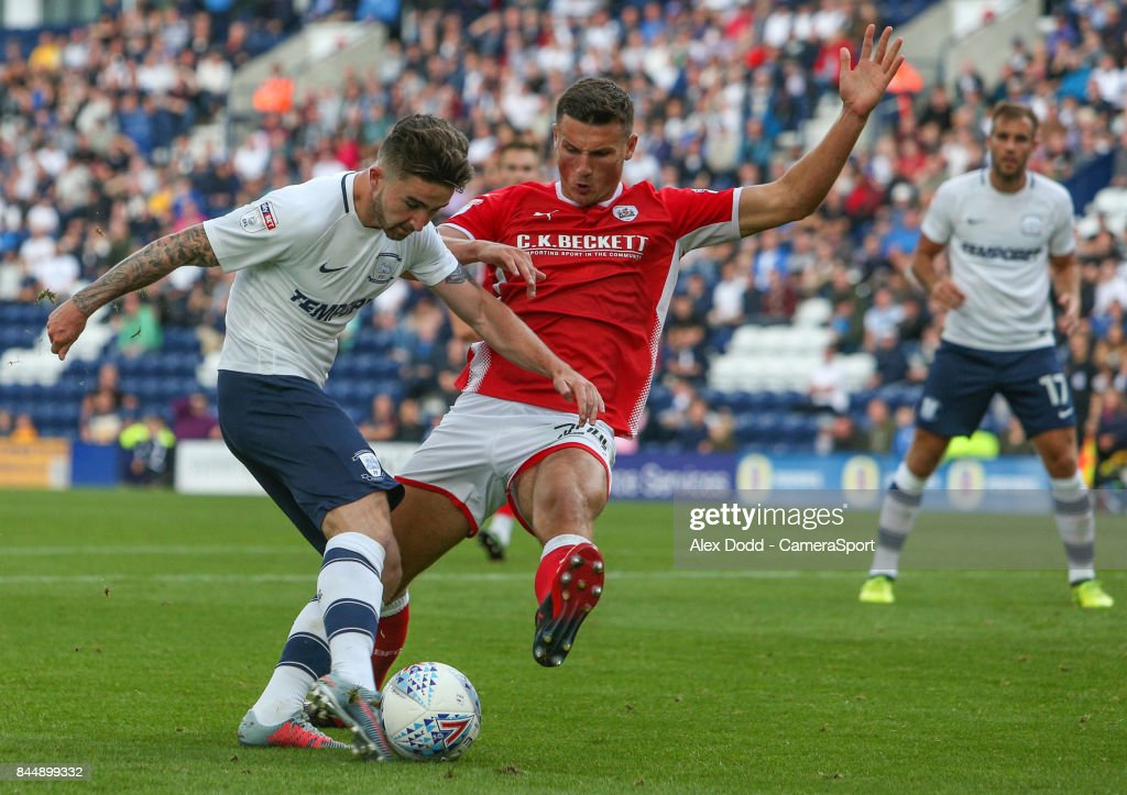 Preston North End's Sean Maguire shoots at goal under pressure from Barnsley's Matty Pearson during the Sky Bet Championship match between Preston North End and Barnsley at Deepdale on September 9, 2017 in Preston, England.