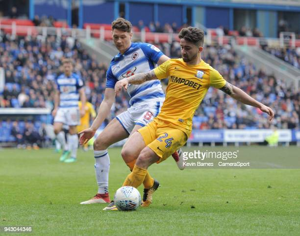 Preston North End's Sean Maguire under pressure from Reading's George Evans during the Sky Bet Championship match between Reading and Preston North...