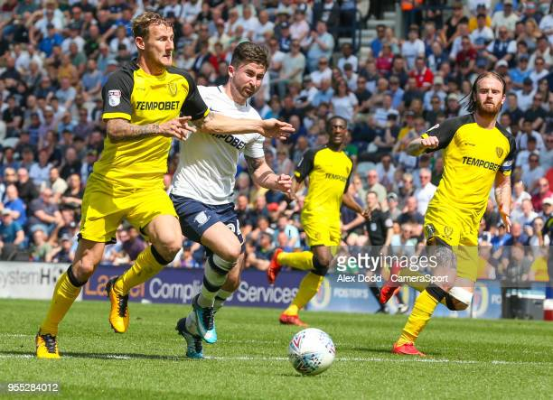 Preston North End's Sean Maguire vies for possession with Burton Albion's Kyle McFadzean during the Sky Bet Championship match between Preston North...