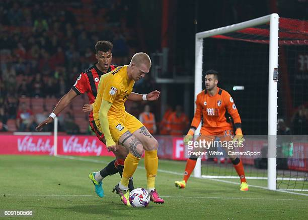 Preston North End's Simon Makienok shields the ball from Bournemouth's Tyrone Mings during the EFL Cup Third round match between Bournemouth and...