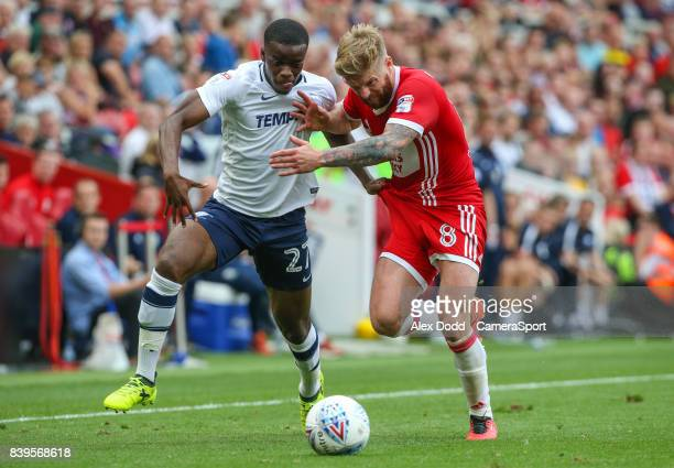 Preston North End's Stephy Mavididi vies for possession with Middlesbrough's Adam Clayton during the Sky Bet Championship match between Middlesbrough...
