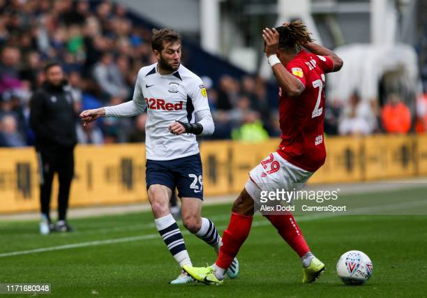 Preston North End's Tom Barkhuizen battles with Bristol City's Ashley Williams during the Sky Bet Championship match between Preston North End and...