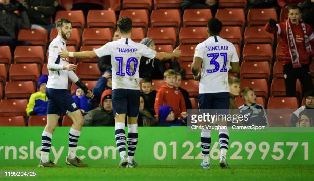Preston North End's Tom Barkhuizen left celebrates scoring his side's third goal with teammates Josh Harrop centre and Scott Sinclair during the Sky...