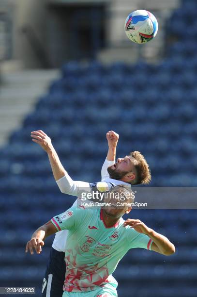 Preston North End's Tom Barkhuizen vies for possession with Swansea City's Ben Cabango during the Sky Bet Championship match between Preston North...