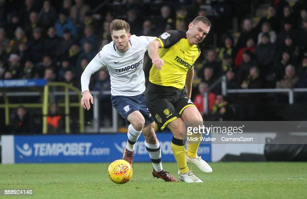 Preston North End's Tom Barkuizen battles with Burton Albion's Jake Buxton during the Sky Bet Championship match between Burton Albion and Preston...