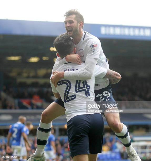 Preston North End's Tom Barkuizen celebrates scoring his sides third goal with Sean Maguire during the Sky Bet Championship match between Birmingham...