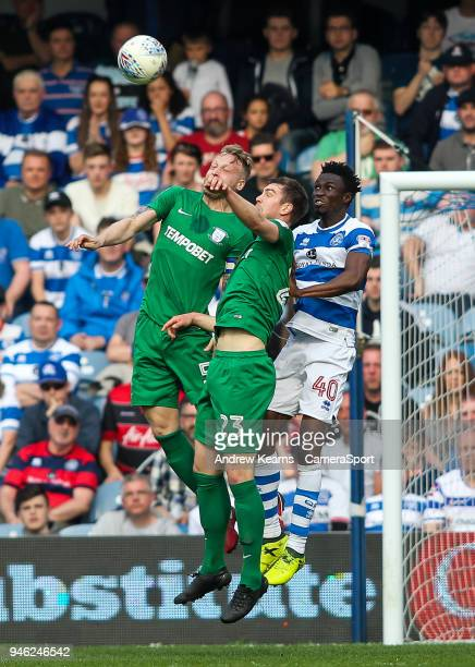 Preston North End's Tom Clarke and Paul Huntington competing with Queens Park Rangers' Chay Tilt during the Sky Bet Championship match between Queens...