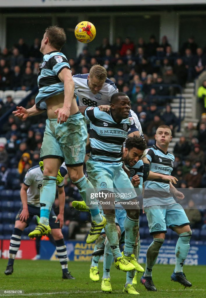 Preston North End's Tom Clarke competes in the air with Queens Park Rangers' Nedum Onuoha during the Sky Bet Championship match between Preston North End and Queens Park Rangers at Deepdale on February 25, 2017 in Preston, England.