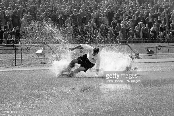 Preston North End's Tom Finney splashes through a puddle