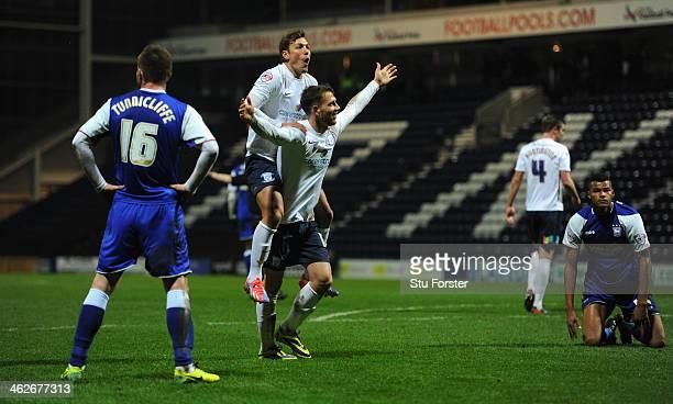 Preston player Joe Garner celebrates with Lee Holmes after Garner had scored his third and Preston's third goal during the Budweiser FA Cup Third...