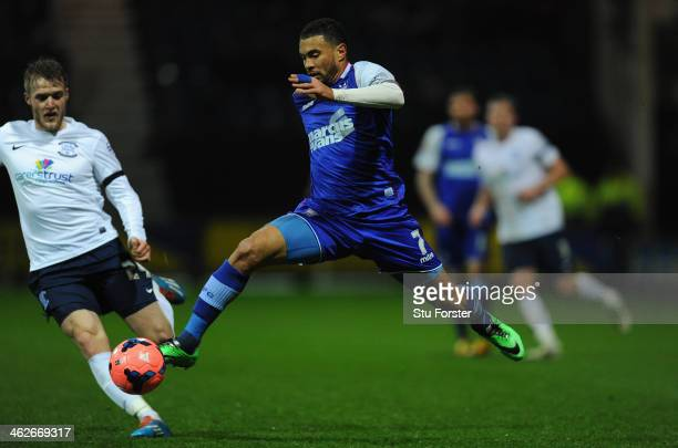 Preston player Will Hayhurst is held off by Ipswich player Carlos Edwards during the Budweiser FA Cup Third Round Replay between Preston North End...