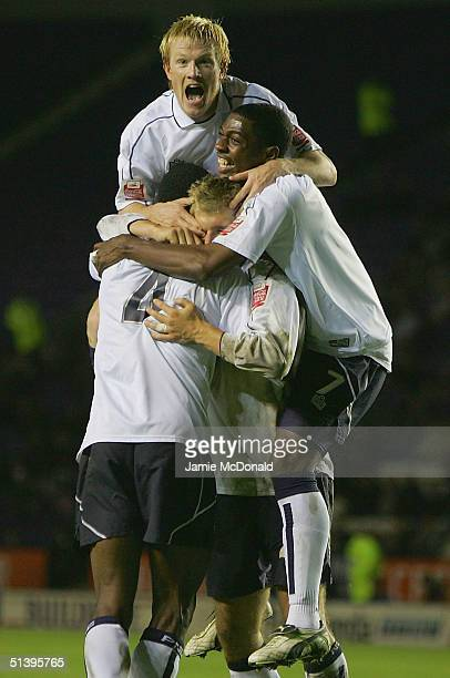 Preston players celebrate their third goal during the Carling Cup second round match between Leicester City and Preston North End on October 4 2004...