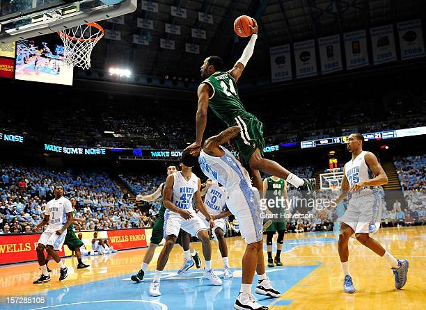Preston Purifoy of the UAB Blazers draws a charging foul on a drive to the basket as he collides with Leslie McDonald of the North Carolina Tar Heels...
