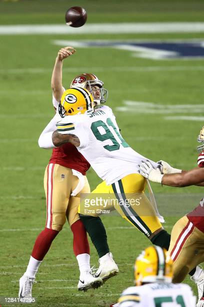 Preston Smith of the Green Bay Packers hits Nick Mullens of the San Francisco 49ers forcing an interception at Levi's Stadium on November 05, 2020 in...