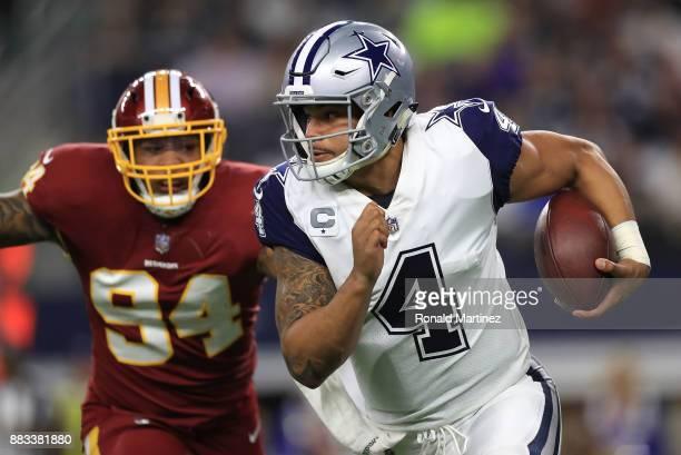 Preston Smith of the Washington Redskins pursues Dak Prescott of the Dallas Cowboys in the first half of a football game at ATT Stadium on November...