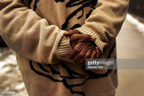 Preston Solomon's hands are viewed as he speaks in front of his current residence at the Auburn Family Residence a shelter for homeless families and...