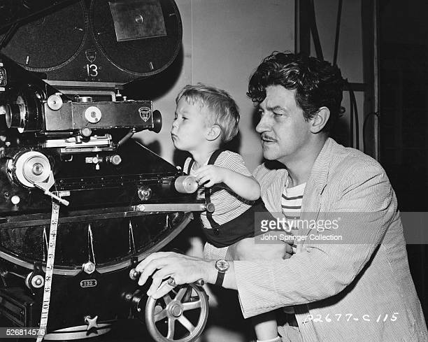 Preston Sturges Helping Child Look Through Camera