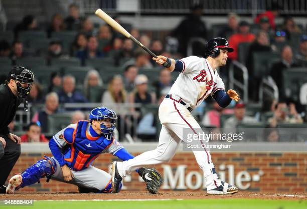 Preston Tucker of the Atlanta Braves knocks in three runs with a double in the seventh inning against the New York Mets at SunTrust Park on April 19...