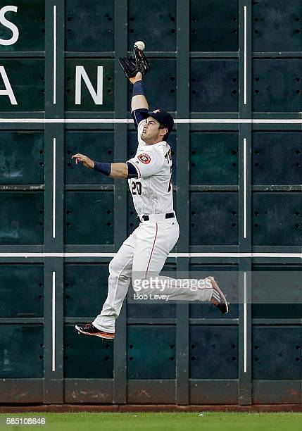 Preston Tucker of the Houston Astros has a line drive by Devon Travis of the Toronto Blue Jays go off the top of his glove in the third inning for a...
