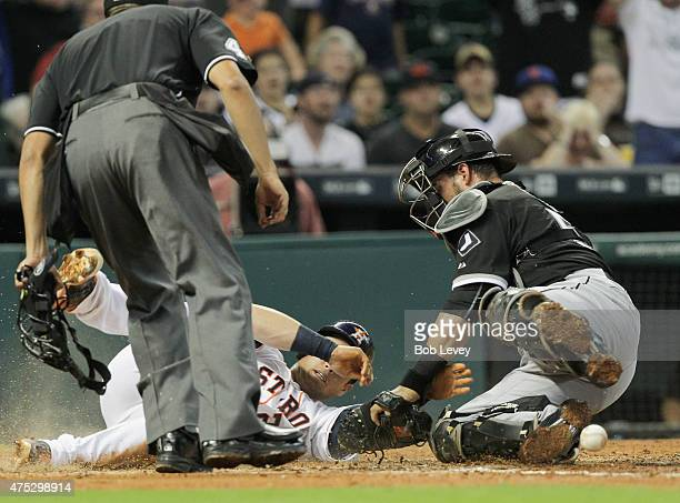 Preston Tucker of the Houston Astros scores in the fourth inning as Geovany Soto of the Chicago White Sox can't handle the throw at Minute Maid Park...