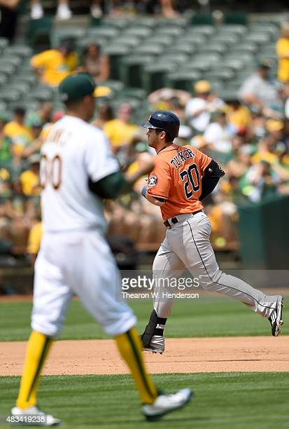 Preston Tucker of the Houston Astros trots around the bases after hitting a solo home run off of Jesse Chavez of the Oakland Athletics in the top of...