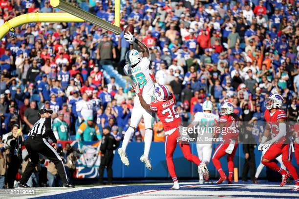 Preston Williams of the Miami Dolphins attempts to catch the ball as Levi Wallace of the Buffalo Bills defends him during the fourth quarter of an...