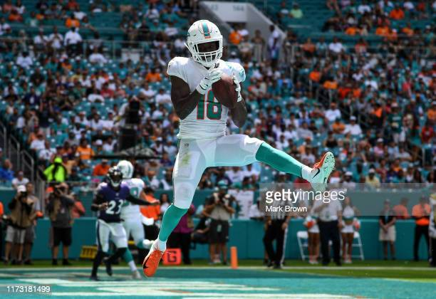 Preston Williams of the Miami Dolphins catches a touchdown in the second quarter against the Baltimore Ravens at Hard Rock Stadium on September 08,...