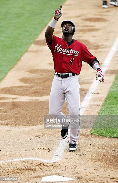 Preston Wilson of the Houston Astros points to the sky after his first inning home run against the New York Mets on July 22 2006 at Shea Stadium in...