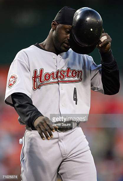Preston Wilson of the Houston Astros walks off the field after the Astros failed to score with the bases loaded in the fourth inning against the...