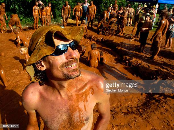 Preston Wright, the official mascot of the 14th Annual Summer Redneck Games, talks with friends near a mud pit during the games July 10, 2010 in East...