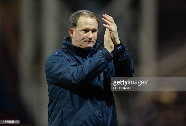 Preston's English manager Simon Grayson applauds the supporters at the end of the FA Cup fifth round football match between Preston North End and...