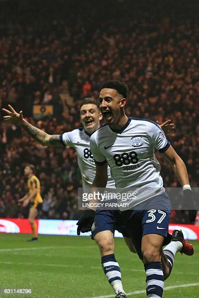 Preston's English striker Callum Robinson celebrates with Preston's English striker Jordan Hugill after scoring the opening goal of the English FA...