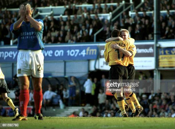 Preston's goalscorer Lee Cartwright is hugged by Jon Macken as Portsmouth's Scott Hiley holds his hands to his head in despair