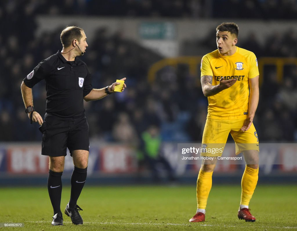 Preston's Referee Jeremy Simpson shows a yellow card to Preston's Jordan Hugill during the Sky Bet Championship match between Millwall and Preston North End at The Den on January 13, 2018 in London, England.