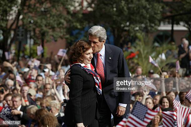 Presumed Democratic presidential candidate Senator John Kerry pauses to speak to his wife Teresa Heinz Kerry during a rally in downtown Pittsburgh,...