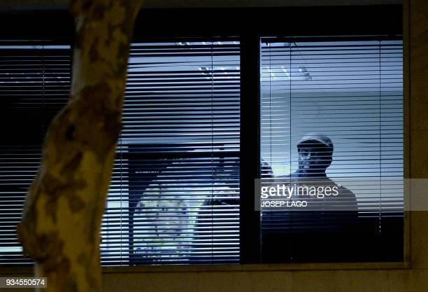 A presumed Malian man and the wife of Mali's honorary consul are pictured inside the consulate of Mali in Barcelona on March 19 2018 Police on Monday...