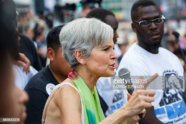 Presumptive 2016 Green Party presidential nominee Jill Stein speaks with 'Black Men for Bernie' supporters of former Democratic presidential...