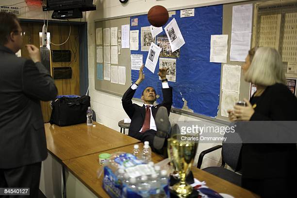 Presumptive Democratic presidential candidate Sen Barack Obama plays with a basketball while meeting with his senior staff backstage at a town hall...