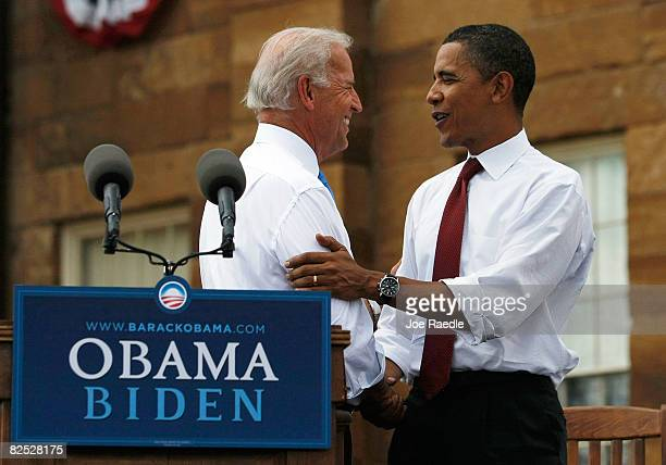 Presumptive Democratic Presidential candidate U.S. Sen. Barack Obama shakes hands with his Vice Presidential pick Sen. Joe Biden on stage in front of...