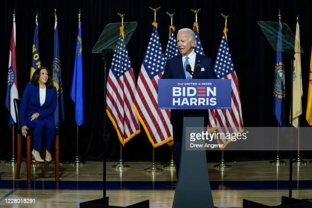 Presumptive Democratic presidential nominee former Vice President Joe Biden speaks as his running mate Sen Kamala Harris looks on during an event at...