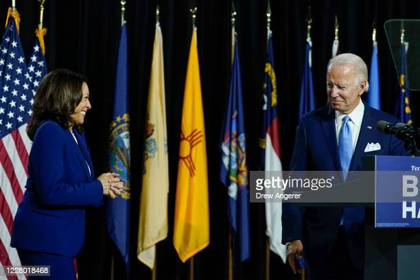 Presumptive Democratic presidential nominee former Vice President Joe Biden invites his running mate Sen. Kamala Harris to the stage to deliver...