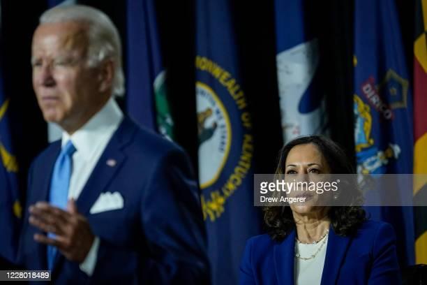 Presumptive Democratic presidential nominee former Vice President Joe Biden speaks as his running mate Sen. Kamala Harris looks on during an event at...