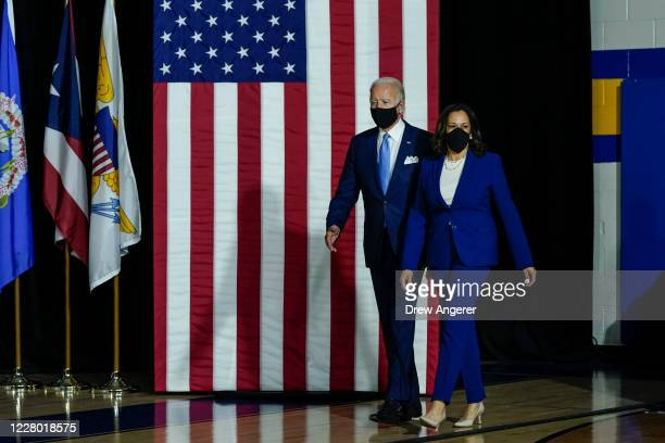 Presumptive Democratic presidential nominee former Vice President Joe Biden and his running mate Sen. Kamala Harris arrive to deliver remarks at the...