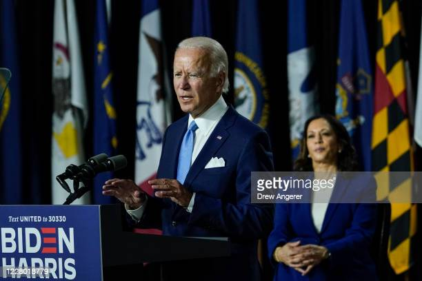 Presumptive Democratic presidential nominee former Vice President Joe Biden speaks as his running mate Sen. Kamala Harris looks on during an event at...