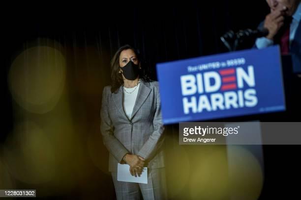Presumptive Democratic vice presidential nominee, U.S. Sen. Kamala Harris listens as presumptive Democratic presidential nominee former Vice...