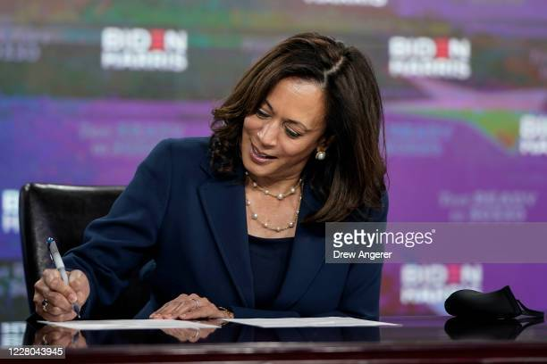 Presumptive Democratic vice presidential nominee, U.S. Sen. Kamala Harris signs required documents for receiving the Democratic nomination for Vice...