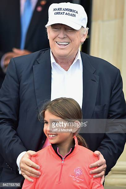Presumptive Republican nominee for US president Donald Trump and his granddaughter Kai Trump arrive at his Trump Turnberry Resort on June 24 2016 in...